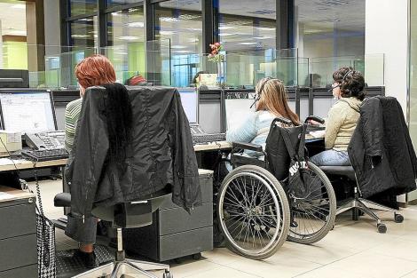 Personas discapacitadas en sus trabajos